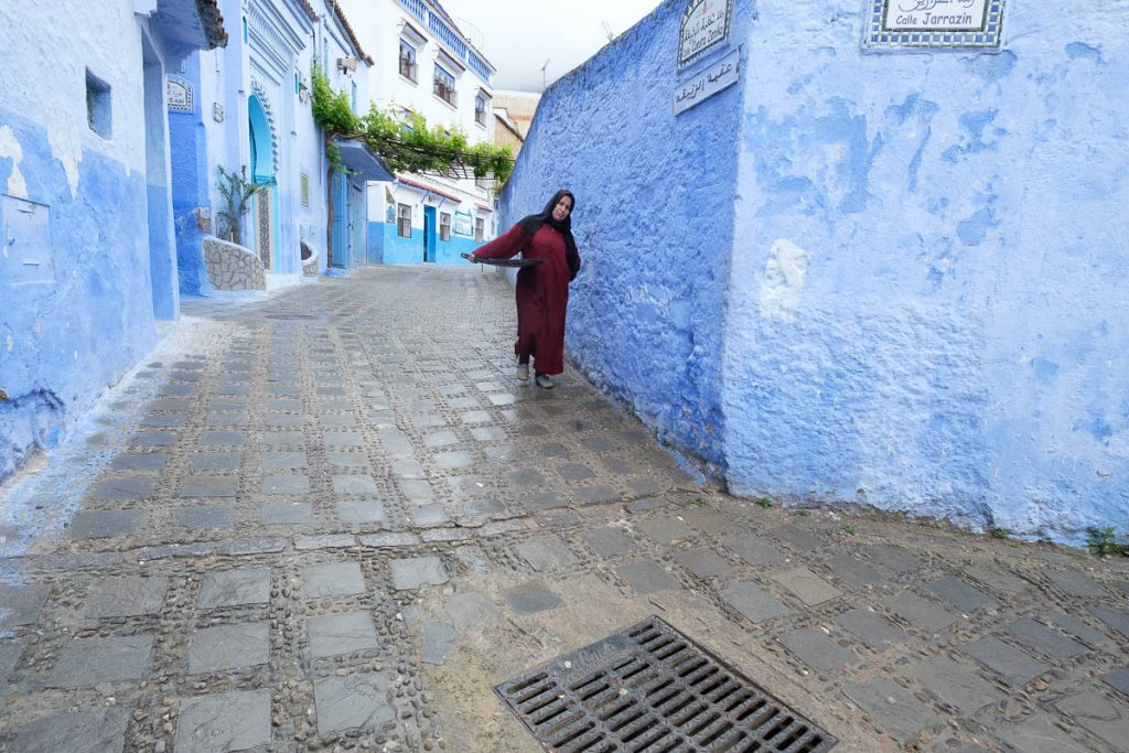 Lady in the street of the Blue city