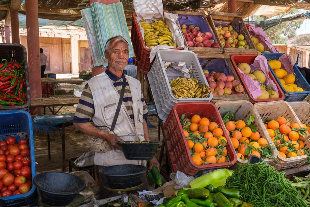 A Moroccon  farmer selling his produce at the market